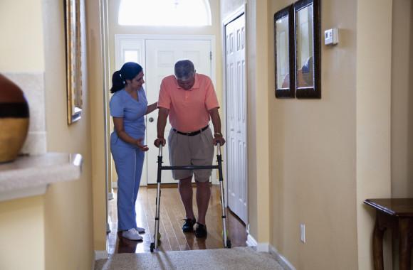 Home health aide with senior man