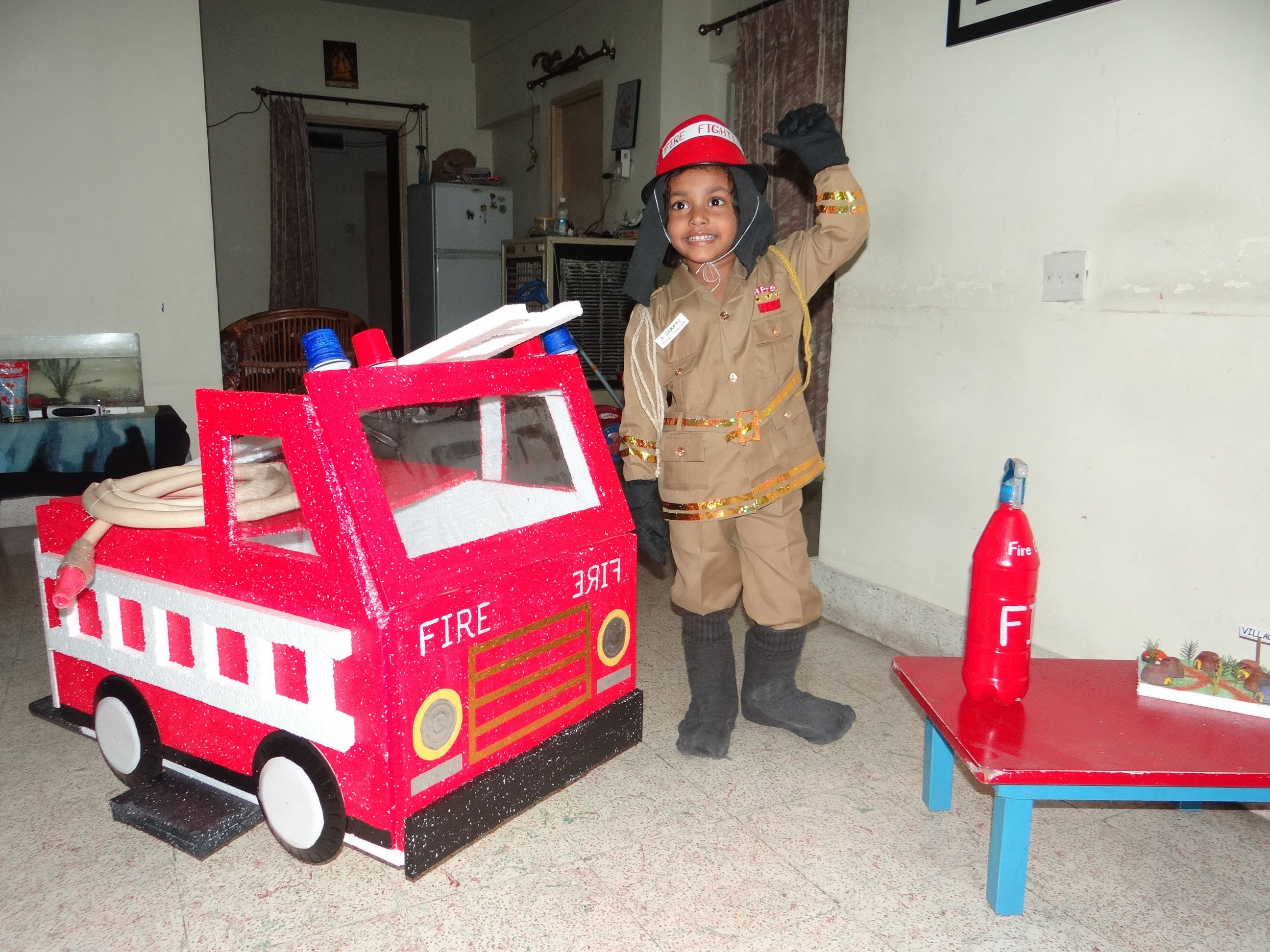 boy in fire safety dress